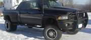 "Bob - Gilmanton, NH 2002 Dodge 3500 DRW 4X4 (has 4"" lift) with Rickson 19.5"" X 7.5"" Black powder coated steel wheels, 265/70R19.5 tires and stainless steel trim rings. Aftermarket lugs (this style dually lug now defunct). Hub covers shown here and alternate lugs are available."