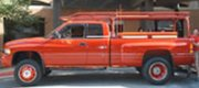 "Gary - Little Rock, AK 2000 Dodge 3500 DRW 4WD with Rickson 19.5"" X 6.75"" Red Powder Coated Steel Wheels, 245/70R19.5 Tires, 19.5"" Stainless Steel Trim Rings and Dodge Factory Center Caps."