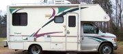 "Richard - Tellico Plains, TN 1999 Ford E-350 C-Class Motorhome with 19.5"" X 6"" Grey E-Coat Steel Wheels and 225/70R19.5 Tires."