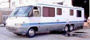 "Frank - Jacksonville, FL 1990 GM P-30 Motorhome with Ricksons 19.5"" X 7.5"" Wheels and 245/70R19.5 Tires in Front. 19.5"" X 6"" Powder Coated Steel Wheels and 8R19.5 Size Tires in the Rear (6). Stainless Steel Simulators on all outside wheels. (Note: In this case, the 245 size tires were selected for the front for both the added weight capacity (4,500 Lbs. per tire) as well as the wider stance than the narrow 8R19.5s, for better handling and steering)."