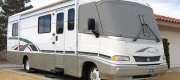 "Robert - Las Vegas, NV 1997 F-53 Motorhome with 19.5"" X 6"" White Powder Coated Steel Wheels with Bridgestone R250 225/70R19.5 Load Range F / Highway Tread Tires up Front and Bridgestone M729F 225/70R19.5 Load Range F / Mud & Snow Rated Tires in the rear (AKA ""drive/steer"" tire set up). Also, aftermarket Lug Nuts and Lug Nut Covers, Hub Covers and Rickson 19.5"" Stainless Steel Trim Rings."
